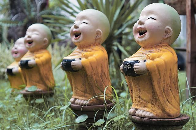 buddhist-monk-children-statues-1