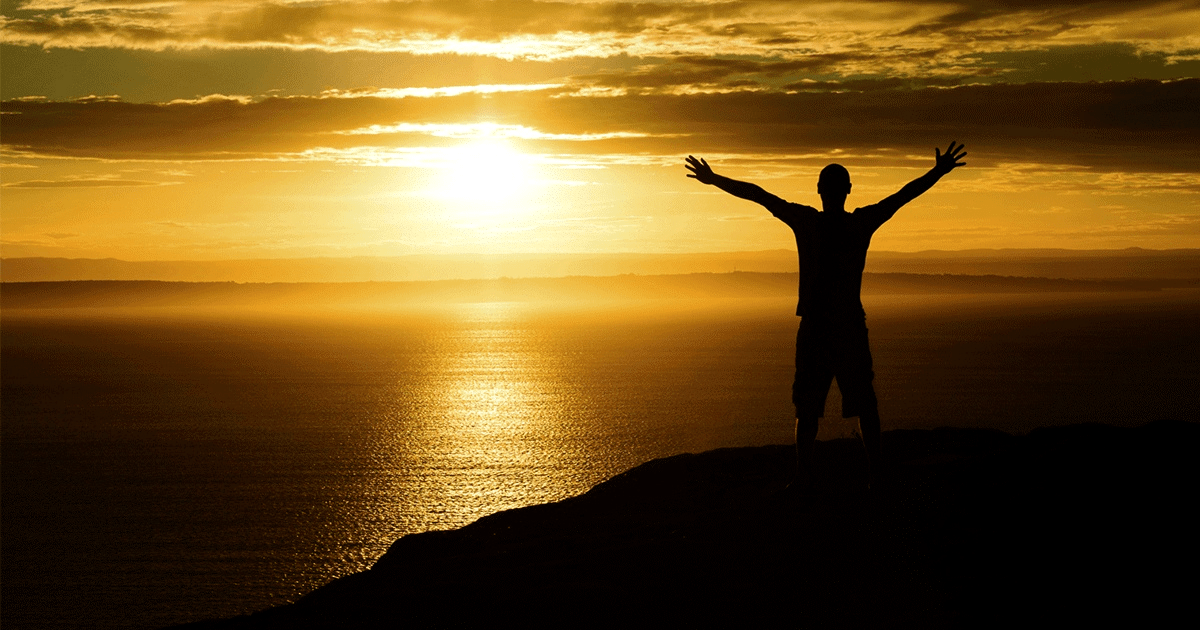 14462-sunset-mountain-silhouette-person-arms-raised-social.1200w.tn-1