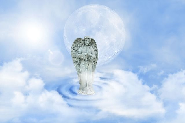 guardian-angel-statue-blue-sky-clouds-small