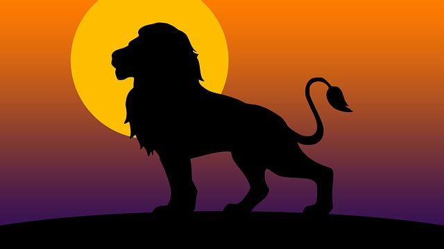 lion-illustration-black-on-orange-full-moon-background-small