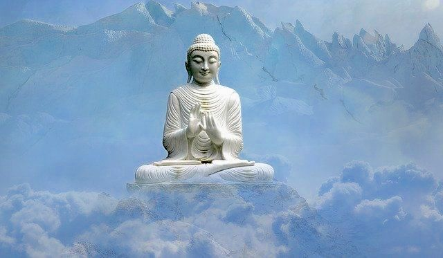 buddha-staute-sitting-cross-legged-behind-clouds_small