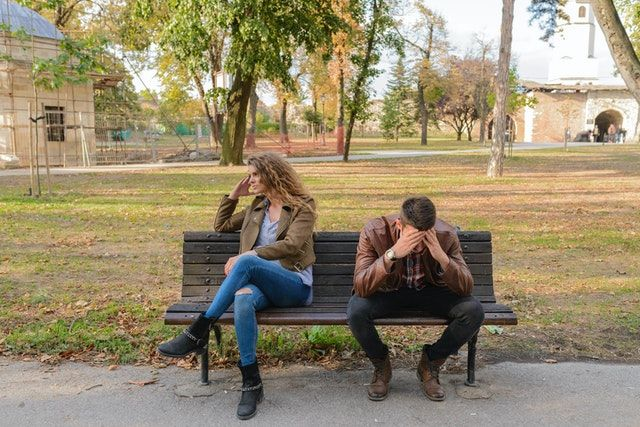 woman-and-man-sitting-on-brown-wooden-bench-small