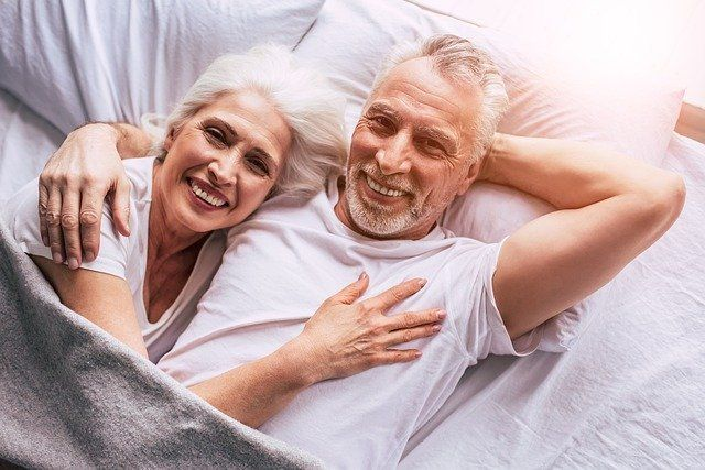 happy-senior-couple-in-bed-smiling_small