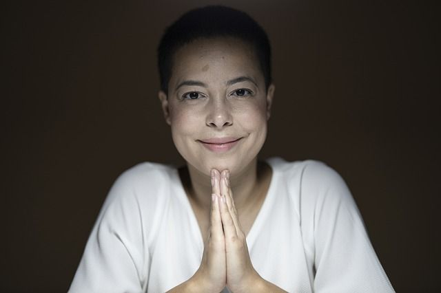 woman-smiling-with-joined-hands-in-prayer_small.jpg